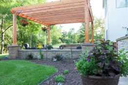 Landscaping design featuring pillars, pavers and pergola