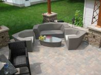 Paver patio with triangular pergola